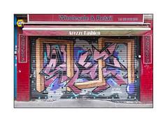 Street Art (HNRX & Sketch), East London, England. (Joseph O'Malley64) Tags: hnrx sketch hnrxsketch streetart urbanart graffiti eastlondon eastend london england uk britain british greatbritain art artist artistry artwork mural muralists shutter rollershutter shop shopfront clothingshop signs signage awning burglaralarm padlocks brickwork bricksmortar pointing padlocked wheelchairaccess ramp match urban urbanlandscape aerosol cans spray paint accuracyprecision