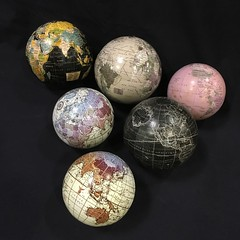 OFFICE SUPPLIES:  A large collection of globes.