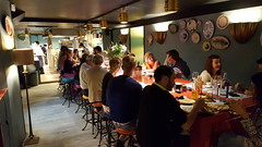 Inside Marcelo, large table for everyone to sit, eat and socialise at!