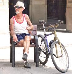 An old sportsman (chrisk8800) Tags: barcelona life street city portrait people urban face sunglasses bike bicycle lumix photography spain cigarette candid smoke stranger smoking panasonic g6 tobacco strawhat sportman