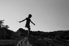 girl on rocks (gorbot.) Tags: blackandwhite sicily sicilia canoneos5d silverefex carlzeisszf50mmplanarf14