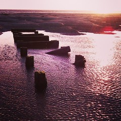 Wooden strutts abandoned in the water at low tide as the sun is setting... (JAX GALLERY 587) Tags: square squareformat unknown iphoneography instagramapp uploaded:by=instagram