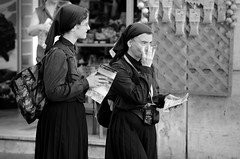 Which way to the Vatican? (Just Ard) Tags: street urban bw italy woman white black rome roma monochrome photography mono nikon women italia habit map candid streetphotography 85mm nun nikkor unposed spectacles lazio d7000 viaagonale justard