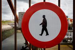 Man walking (paul indigo) Tags: sign warning walking gate harbour signage locked paulindigo