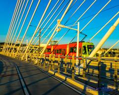 Panning Portland Streetcar On the Tilikum Crossing (AvgeekJoe) Tags: bridgeofthepeople d5300 dslr nikon nikond5300 oregon portland tilikumcrossing tilikumcrossingbridgeofthepeople willametteriver bridge cablestayedbridge transitbridge sunset