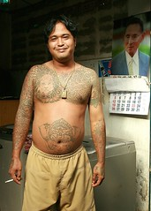a tattooed guy and the king (the foreign photographer - ) Tags: young tattooed man king portrait calendar bangkhen bangkok thailand khlong thanon canon