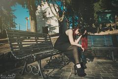 Goodbye city (Grazia Mele) Tags: girl hat redhair redlips goodbye nuoro sardinia