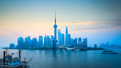 shanghai skyline in daybreak (DJANDYW.COM & DJANDYW.TV AKA ANDREW WILLARD) Tags: daybreak scene shanghai skyline river dawn city blue building business tranquil architecture asia modern office china chinese cityscape financial landmark sky cloud skyscraper tourism tower travel urban view water waterfront sunrise peaceful pleasure boat scenery pearl oriental huangpu beautiful background serenity morning glow rosy