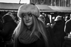 Seasonal Wrappings (Leanne Boulton) Tags: people monochrome urban street candid portrait portraiture streetphotography candidstreetphotography candidportrait streetportrait streetlife woman female blonde face facial expression look emotion feeling winter cold weather wrapped fur scarf chunkyknit backlit christmas market tone texture detail depthoffield bokeh natural outdoor light shade shadow city scene human life living humanity society culture canon 5d canoneos5dmarkiii 70mm ef2470mmf28liiusm character black white blackwhite bw mono blackandwhite glasgow scotland uk