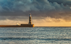 Early Morning Light Over Roker Lighthouse (robinta) Tags: clouds sky dramatic moody pier lighthouse buildings architecture historic landmark brick stone harbour colour color sunderland roker pentax sigma18200mmhsmc ks1 landscape seascape sea ocean water contrast details light shadows wave surf