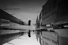 after the rain... (maekke) Tags: zürich hardbrücke zvv sbb trainstation reflection puddlegram silhouette man pointofview pov umbrella streetphotography fujifilm x100t 2016 ch switzerland bw noiretblanc 35mm