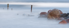Negaiss (Gatis Gribusts) Tags: sea waves stones sigma105mm