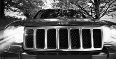 OIIIIIIIO (TP Photographer) Tags: 2008 08 jeep grand cherokee 30 v6 crd diesel overland 4x4 suv grille car automotive photography tpphotographer tpphotography tp design canon dslr slr 500d eos oiiiiiiio presence power front full frame wide angle 10mm lens black white bw mesh badge trademark hid xenon luxury contrast chrysler mercedes benz wk air intake cooling detroit usa america brand american