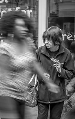 Miles away (BazM:Photog.......:-)) Tags: blur manchester blackwhite candid thoughtful blurred smoking thinking streetphoto marketstreet smoker deepinthought lostinthought distracted milesaway amomentintime streetcandid smokingwoman standingwoman austeritybritain standingsmoking