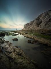 Towards Beachy Head (Matthew Dartford) Tags: longexposure sunset lighthouse motion reflection water sunrise calm cliffs eastbourne beachy beachyhead