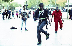 Street Dance (gc6paris) Tags: street summer black paris france art film water bike kids youth walking french glasses nikon place dynamic faces kodak watching chinese young statues clothes monks laugh breakdance f80 monuments expired tramp