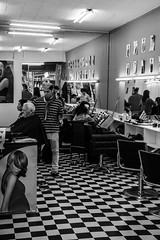 Hairstyling Beneath Harsh Lights (Pauls-Pictures) Tags: street city people urban blackandwhite haircut shop work hair photography store image cut candid portait sony crowd 7 style australia melbourne hairdresser salon worker kit 1855 alpha dresser hairstyle cuts customes crowded hairstylist nex photogaphy streetphotograhy workng sonynex7 alphasonynex7
