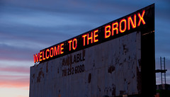 Welcome to the Bronx (Globalviewfinder) Tags: new york nyc light sunset red usa sun sign night evening twilight wire neon state five bronx united boroughs crime area suburb states welcome rough barbed neighbourhood boro inequality eyesore