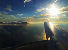 Sunset Flight over Chicago (` Toshio ') Tags: sunset sun lake chicago water clouds plane airplane flying illinois aircraft air flight wing jet lakemichigan greatlakes flare jetplane iphone toshio