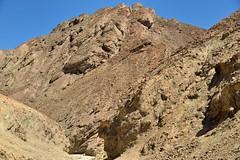 Strange Formations of Rocks (Death Valley National Park) (thor_mark ) Tags: amaragosarange blueskies capturenx2edited cliffwalls cliffface cliffs colorefexpro day3 deathvalleynationalpark desertlandscape goldencanyontrail greatbasinranges hillsides lookingeast nature nikond800e project365 triptodeathvalleyandcalifornia westgreatbasinranges furnacecreek california unitedstates