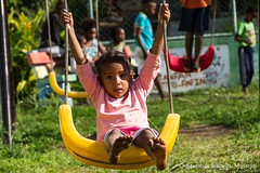 Teeter-Trotter (A SHOT FOR A SMILE ) Tags: enfant ile maurice mauritius portraiture portrait stefania isabella massoni shot for smile happiness boy child joy glimpses street urban photographers travel world canon7d girl photography streetlife streetphoto no filter real life friend paololivonos face faces humans human rights childhood future smassoni africa people love flickraward flicker wordlstreetphoto one good vibrations energy positive soul game afterschool school swing seesaw play slide teetertrotter kidgarden