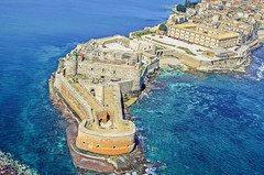Fortress Maniace in Syracuse Sicily (Michele Ponzio) Tags: fortress castle architecture tower building city old tourism travel wall fort sea blue rocks blu boat aerialview cliff reef blockhouse castello fortezza ortigia syracusesicily sicily siracusa ngc flickrsicilia wife hot sex sexy pussy fuck cum