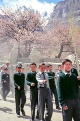 School boys practicing march, Gulmit, Pakistan (travelingmipo) Tags: travel photo film pakistan     pakistani  pamir karakoram   hunza hunzavalley  karakoramhighway  kkh gulmit  gojal  spring  cherryblossoms cherries  flowers people apricot   boy kids