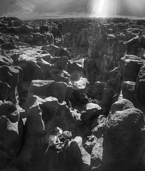 Chilling at the Fossil Falls (PeterThoeny) Tags: california fossilfallsscenicarea fossilfalls fossilfallstrailhead rock boulder canyon day clear desert hdr 3xp raw nex6 selp1650 photomatix outdoor qualityhdr qualityhdrphotography landscape light ray sunray monochrome blackandwhite