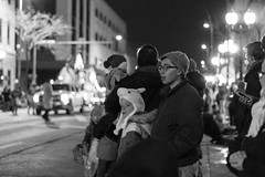 Taking in the sights (LostOne1000) Tags: watching cedarrapids fireandice city cold blackwhite iowa parade night unitedstates downtown us holidaydelightparade