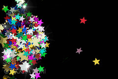 Colorful stars on black background (PicciaNeri) Tags: glow festivities glitter starshape xmas christmas starnight birthday decorative seasonal festive celebration text background aspirations goldstar card black closeup goldenconfetti celebrate sparkle confettistars border december present color goldconfetti winter gift copyspace dreams party goldenstars gold confetti star holiday metallic greetings holidaycard blue colorful message blank motif ornate goldstars decoration colourful goldenstar nobody velvet happy golden