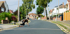 SUBURBAN SURFING (charlieallen.77) Tags: skate skateboard skatebaording longboarding longboard sun summer trees green street suburban nikon essex uk sport action urban road