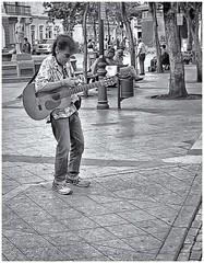 Musico Callejero (Street Musician) (Samy Collazo) Tags: plazadearmas musico musician musicocallejero streetmusician sanjuan oldsanjuan viejosanjuan puertorico canonlld21955leicacopy industar22f35 kodaktrix400 kodakd76 kodakfixer kodak lightroom aviary niksilverefexpro2 bn bw