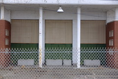 """Getting it's """"No Trespassing"""" point across (BDRoth (very slowly catching up)) Tags: concrete door detroit state fair fence brick lines texture building abandoned"""