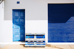 Blue doors in Formentera, Spain (Naomi Rahim (thanks for 3 million visits)) Tags: formentera ibiza spain espaa balearicislands mediterranean island town europe europa travel travelphotography nikon nikond7200 wanderlust santfrancescxavier architecture blue door crates siesta street streetphotography summer santfrancescdeformentera