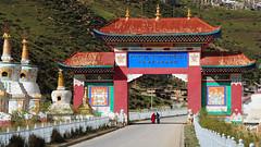 The Entrance Gate of Larung Gar, Tibet 2013 (reurinkjan) Tags: monastery 2013 བོད་ལྗོངས། ©janreurink tibetanplateauབོད་མཐོ་སྒང་bötogang tibetབོད buddhistསངས་རྒྱས་ཆོས་ལུགས་པ nunneryཨ་ནི་དགོན་པ་anidgonpa monkགྲྭ་བ།grwaba buddhismསངས་རྒྱས་ཆོས་ལུགས།sangsrgyaschoslugs greatertibetབོད་ཆེན་པོböchenpo tibetannationalitytibetansབོད་རིགས།bodrigs tibetannationtibetanpeopleབོད་ཀྱི་མི་བརྒྱུདbökyimigyü nunཇོ་མོ།ani sisterhoodཨ་ནིའི་ཚོགས་པanitsokpa khamཁམས།easterntibet ༢༠༡༣ khamཁམས་བོད khamsbodkhamwö sertalགསེར་ཐར།countyserthar larunggarབླ་རུང་སྒར། nyingmapahermitage foundedbydudjomlingpainthelate19thcentury khenpojikpunalsorecognizedastertonsogyeltheincarnationoflerablingpa gyutrullhakhang gyultrullhakang tonpeidekhang monasticcollegeshedraoflarunggar