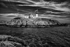 Nubble (Ry Meehan) Tags: ocean trees shadow sky blackandwhite bw lighthouse seascape clouds contrast landscape harbor nikon rocks maine atlanticocean tone nubble capeneddick 1424mmf28 d800e