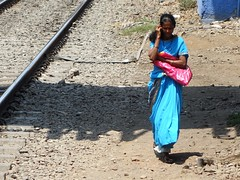Mumbai,  India (posterboy2007) Tags: railroad woman india tracks cellphone mumbai flickrandroidapp:filter=none