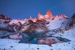 Fitz Roy and Laguna de Los Tres (baddoguy) Tags: morning mountain lake snow reflection argentina sunrise dawn nationalpark twilight fitzroy images getty stillwater massif losglaciares lagunadelostres pinkglow