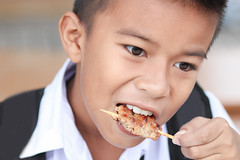 Portrait of little boy eating grilled pork. (By Jan_) Tags: boy portrait people food baby white cute male beautiful smile face childhood breakfast youth asian dessert fun happy person one kid toddler infant funny pretty baker child hand little sweet small joy young happiness tasty son pork biscuit eat human thai meal hungry cheerful grilled caucasian