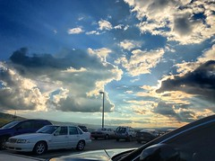 View from the parking lot, 2016.10.03 (Aaron Glenn Campbell) Tags: instagramapp iphoneography uploaded:by=instagram moessouthwestgrill wilkesbarre wyomingvalley luzernecounty nepa pennsylvania clouds sky parkinglot vividhdr ios10 iphone7plus sunflare backlit backlighting vehicles hdr