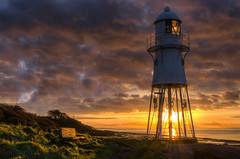 Black Nore lighthouse (~g@ry~ (clevedon-clarks)) Tags: portishead blacknorelighthouse lighthouse coast coastal bristolchannel bristol sunset sunburst bench golden northsomerset somerset