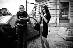 _DSC9337 (stimpsonjake) Tags: nikoncoolpixa 185mm streetphotography bucharest romania city candid blackandwhite bw monochrome women girls phone