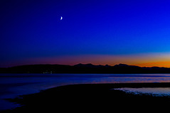 Moon Over Arran (Brian Travelling) Tags: blue sunset water isleofarran isleofcumbrae firthofclyde moon crescentmoon northayrshire ayrshire scotland scenery scenic scottish scots waterscape pentaxkr pentax pentaxdal