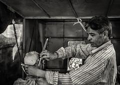 The Haircut (Baron Reznik) Tags: asia asien bw blackwhite candid everydaylife gogunda hair hairsalon horizontal india landofkings monochrome portrait rajasthan republicofindia sayravillage sonyfe24240mmf3563oss village