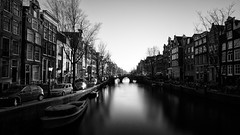 Oudezijds Voorburgwal (miguel_lorente) Tags: holland longexposure sunset houses netherlands bridge winter street bnw city bw blacknwhite boats blackandwhite amsterdam canals