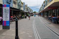 Follow the Line (Jocey K) Tags: newzealand christchurch buildings city signs architecture people street sky newregentst cafes chairs tables clouds shops tramlines