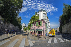 Montmartre, Paris, France (Atomic Eye) Tags: montmartre paris france 18tharrondissement rightbank restaurant cafe outdoors crosswalk cobblestone fisheye blue clouds sky seating umbrella eating pink green sidewalk stone walls