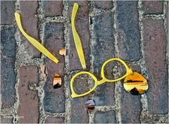 Ex Spectacles (Hindrik S) Tags: spectacles sunglasses bril zonnebril sinnebril yellow giel geel light ground grn grond cobblestone straatklinker broken stikken kapot two glasses street straat strjitte streetphotography straatfotografie sonyphotographing sony sonyalpha slta57 a57 57 tamronaf16300mmf3563dillvcpzdmacrob016 tamron paintshoppro x8 2016