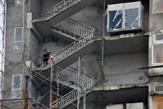 Hot spot (Roving I) Tags: welders workers welding stairs metal steel handrails scaffolding buildingsites apartments projects protection sparks greyness danang vietnam