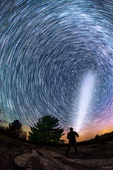 Controlling the Stars (Don Komarechka) Tags: longexposure sky ontario canada nature night fisheye flashlight startrail donkom camelopardalid